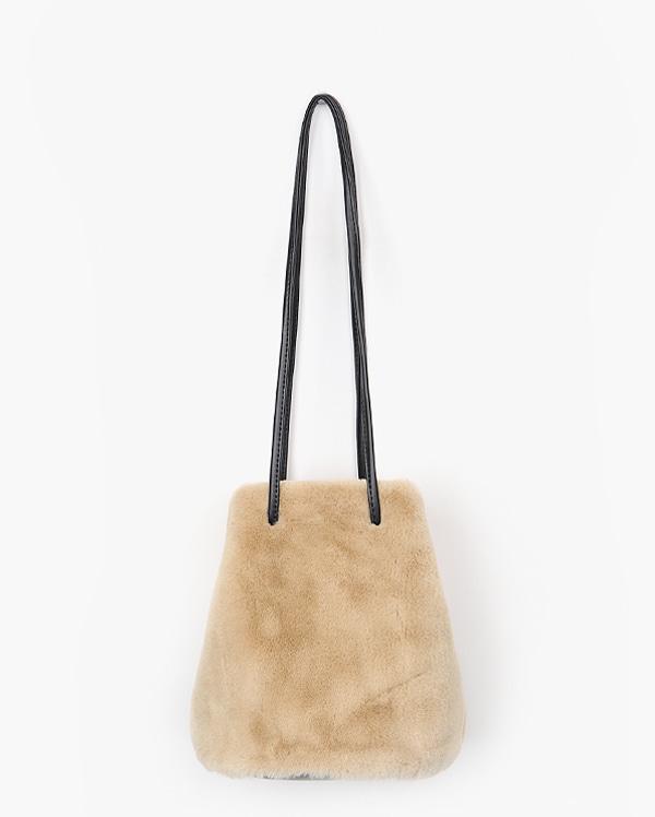 touching fur bag