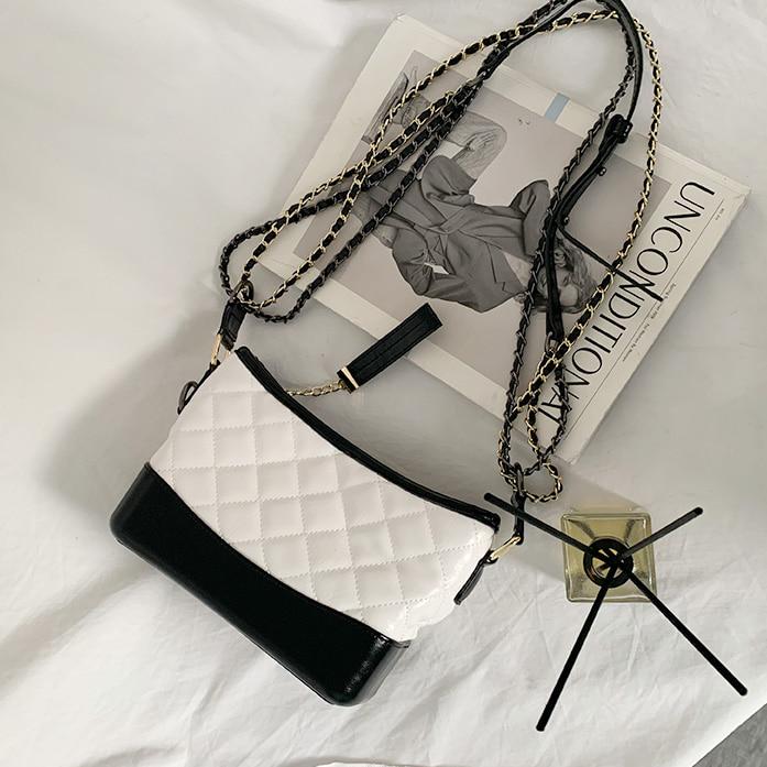 DABAGIRL菱格绗缝拉链包口单肩包