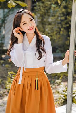 简约纯色V领围裹式韩服女衫