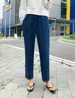 立體縫線腰鬆緊哈倫牛仔褲